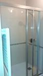 Douche avec paroi coulissante